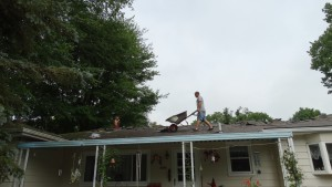 Campbell Roofing workers stripping the old roof.