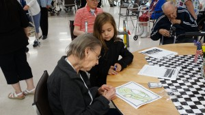 An ADS customer autographs a picture she colored for Madison